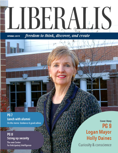 Cover of Liberalis featuring Logan Mayor Holly Daines smiling in front of Logan City Hall.